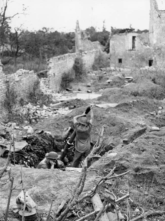 A Canadian 4.2-inch mortar crew in action against the Germans a few days after the landings.