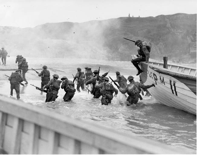 ABOVE: Canadian troops rehearse for Operation Overlord at the Slapton Sands training area in Devon, England. They are disembarking from wooden lifeboats rather than the military landing craft they will come ashore in on D-Day. OPPOSITE: Of all the Allied forces on D-Day, the Canadians made the deepest penetration inland—four miles from Caen.