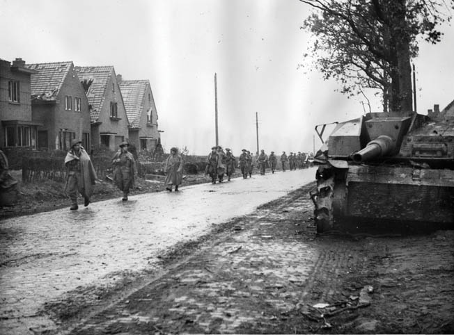 Canadian troops of the Allied 21st Army Group, under the command of General Montgomery, march through a Dutch town in early 1945. Montgomery opposed Eisenhower's broad front strategy and sought to concentrate the main Allied thrust into Germany with his command. To do so, Montgomery continually tried to bring American troops under his personal authority and to divert war matériel from other Allied operations.