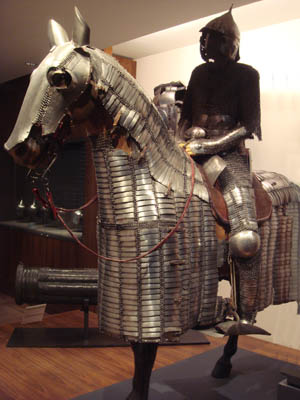 Creators of cataphracts, barding and other types of horse armor used whatever metal was at hand, iron or bronze, and often stiffened the scales with leather.