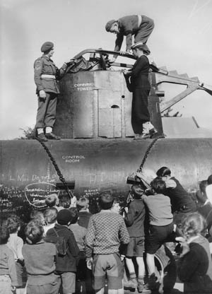 Two of the Japanese submarines that attacked Sydney Harbor were recovered and their crews buried with military honors. A complete submarine was put together using parts of the two recovered craft put on display at Bennelong Point, now the site of the famed Sydney Opera House.