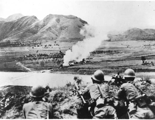 Japanese soldiers occupy an observation post on high ground north of Beijing and watch the bombardment of Chinese positions in the valley below. The highly trained Japanese Kwantung Army, acting initially without sanction from Tokyo, fought to take control of vast areas of China during the 1930s.