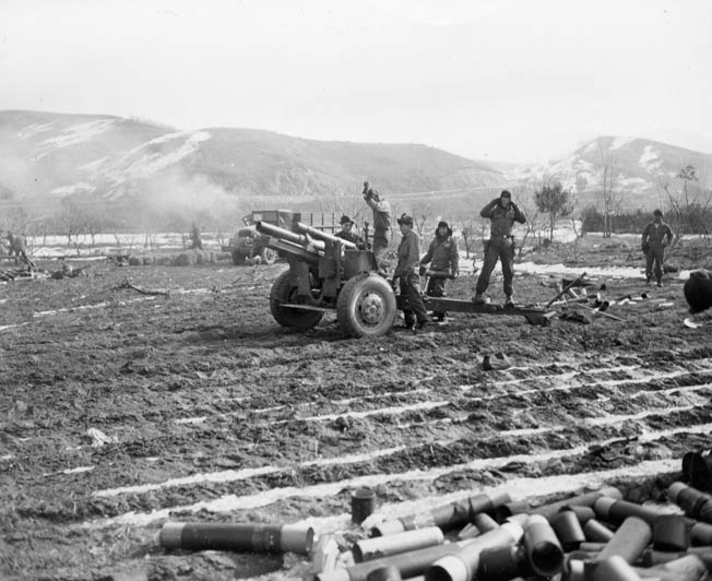 Artillerymen of the U.S. Army X Corps fire on enemy positions at the Chosin Reservoir.