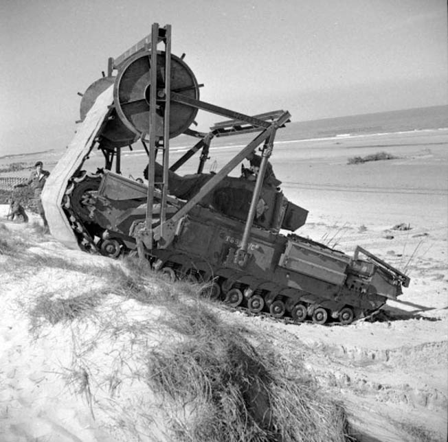 The Churchill ARVE Bobbin featured a 10-foot-wide canvas cloth reinforced with steel poles that unrolled onto the ground. The canvas offered traction over the soft sand of the invasion beaches.