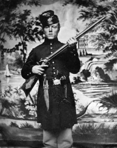 A jaunty and well-armed member of the 2nd U.S. Sharpshooters flourishes a target rifle, Bowie knife, and Colt 1849 pocket revolver.