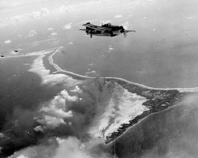 The primary islet of Makin Atoll in the Gilbert Islands, Butaritari is viewed during an American air raid prior to the invasion of the atoll in November 1943. Jones was stationed here in 1941.