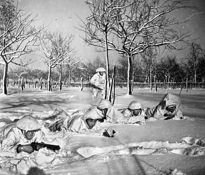 British Commandos in snow-camouflage uniforms on a reconnaissance mission before the Allied offensive toward Germany and the lower Roer River.