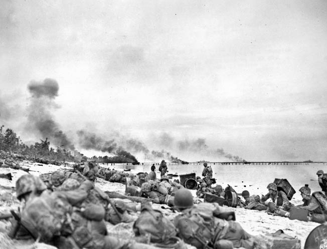 At Peleliu, the Marines of the 1st Division were heavily engaged by the Japanese defenders while they were still on the beach. The Marines of Company K absorbed heavy casualties while attempting to clear The Point, an objective overlooking the landing area on White Beach.