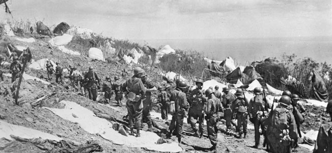 Immediately after reaching the ground on Corregidor, paratroopers of the 503rd Parachute Regimental Combat Team assemble and set off to seize objectives. The paratroopers took on determined Japanese defenders but ultimately wrested the island from enemy control.