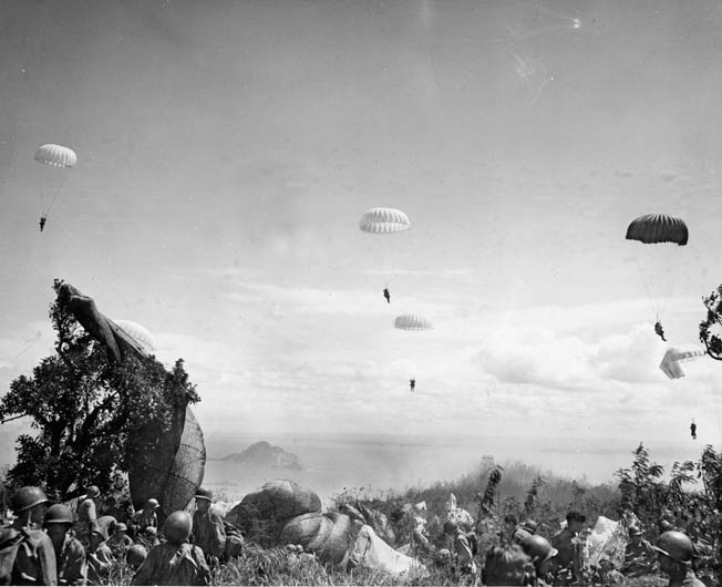 Their parachutes billowing in the sun, members of the 503rd Parachute Infantry Regimental Combat Team plummet toward the golf course on Corregidor. Planners recognized the hazards of the jump into a narrow area that was bounded by cliffs and the waters of Manila Bay.