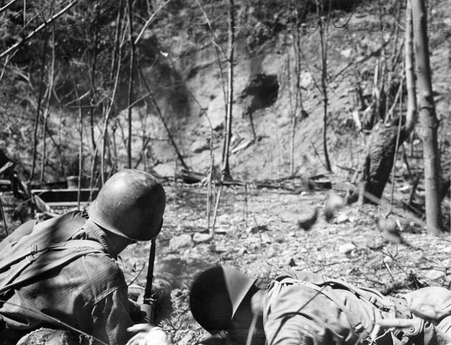 American soldiers fire a 60mm mortar at Japanese troops holed up in a cave on Corregidor. The Americans were forced to root out diehard defenders, some of whom chose suicide rather than surrender.