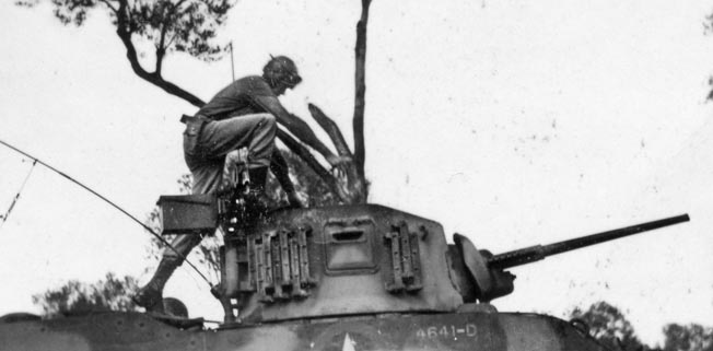 Lieutenant Craig mans his tank. His company spearheaded Patton's final amphibious assault in Sicily, and, thanks to Craig's quick thinking, avoided coming under friendly fire.