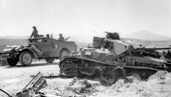 A scout car rolls past a knocked-out German Mark IV medium tank. Brig. Gen. Gay reprimanded Craig and wrote him a poor efficiency report when one of the vehicles in Craig's caravan of two scout cars, a jeep, and a truck broke down.