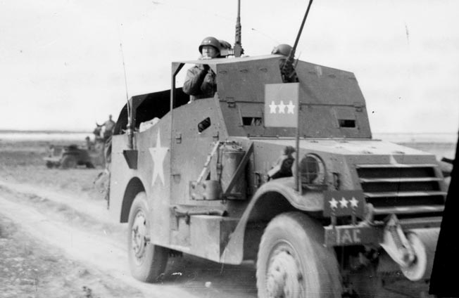 Patton heads to the Tunisian front in his scout car. Craig delivered the vehicle to Patton after driving it and three other needed vehicles across 1,500 miles of North African desert.
