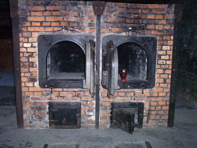 In this recent photo taken inside a crematorium at Auschwitz, the now cold ovens bear mute testimony to the genocide that was prosecuted by the Nazis at the most vilified of all concentration camps.