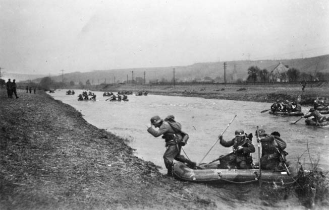 German troops use rubber rafts to cross a river somewhere in France. Lt. Col. Balck accompanied his men across the Meuse near Sedan where the first waves of German infantry took heavy casualities.
