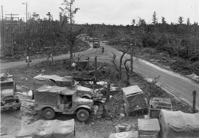 The shattered crossroads at Wahlerscheid, shown on February 13, 1945, after it was recaptured from the Germans, will forever be known as Heartbreak Crossroads to the soldiers of the U.S. 2nd Infantry Division.