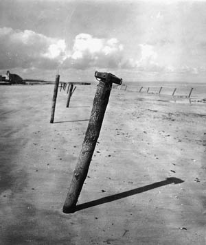 German antitank Teller mines, attached to posts buried in the sand at an angle, were planted liberally across the beaches of Normandy.