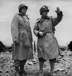 Generals Omar Bradley, left, and Joseph Lawton Collins discuss post-D-Day strategy.