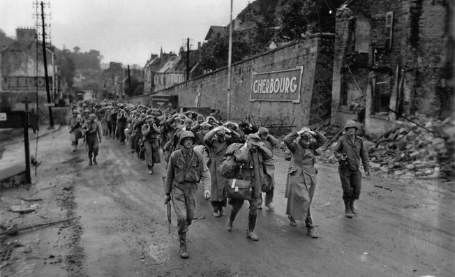 German prisoners are marched through the streets of Cherbourg after their final surrender on June 28.