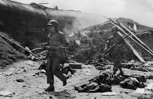 Victorious Americans advance past ruined German defenses outside Cherbourg. The VII Corps lost 22,000 casualties taking the port.