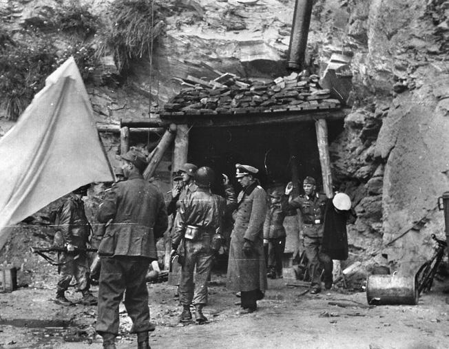 Lieutenant General Karl Wilhelm von Schlieben emerges from his hideout under an ignominious white flag on June 28.