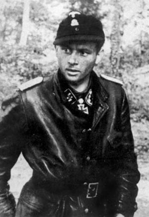 The strain of combat appears evident even on the face of German tank ace Michael Wittmann, photographed in Normandy in June 1944, shortly before his death.
