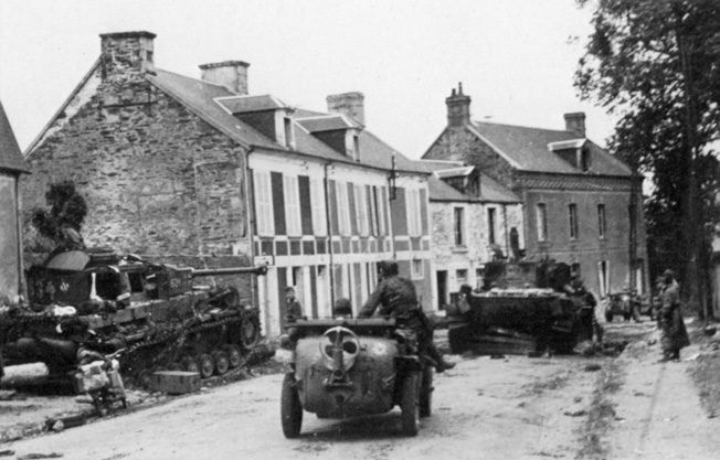 "A PzKpfw IV ""634"" of the Panzer Lehr (far left) has an optimal view of the Villers-Bocage street from its vantage point behind a house."