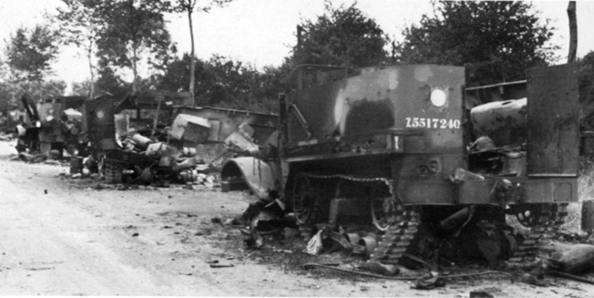 This long line of battered British vehicles is mute testimony to the ferocity of Wittmann's attack at Villers-Bocage. The vehicles were blown up while parked on a hill leading to Point 213 along the N175 road run- ning northeast from the town.