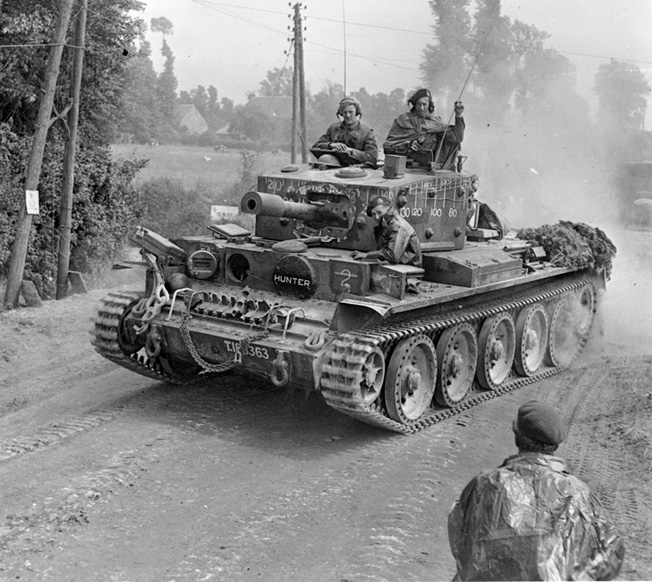 A British tank churns up a cloud of dust on the advance near Tilly-sur-Seulles on June 13, 1944.