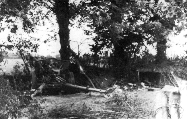 Shown in their camouflaged emplacements at the town of Ste. Marie-du-Mont, these German guns were attacked and silenced by troopers of Easy Company, 506th Parachute Infantry Regiment, on D-Day. Buck Compton was among the paratroopers who took out the guns that threatened Utah Beach.