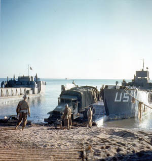 During a quiet D-Day landing rehearsal at Slapton Sands, a truck rolls off the ramp of a landing craft. The Slapton Sands area was chosen for rehearsals of the D-Day operation because the coastline resembled the Utah Beach area in Normandy.