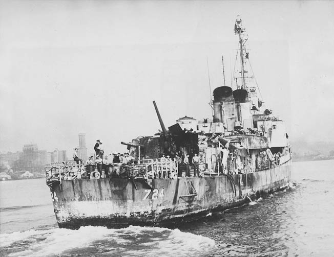 Burned, bruised, and battered but still afloat, the heavily damaged Laffey limps into the port of Seattle for repairs. She would return to sea, but not until after Japan had surrendered.