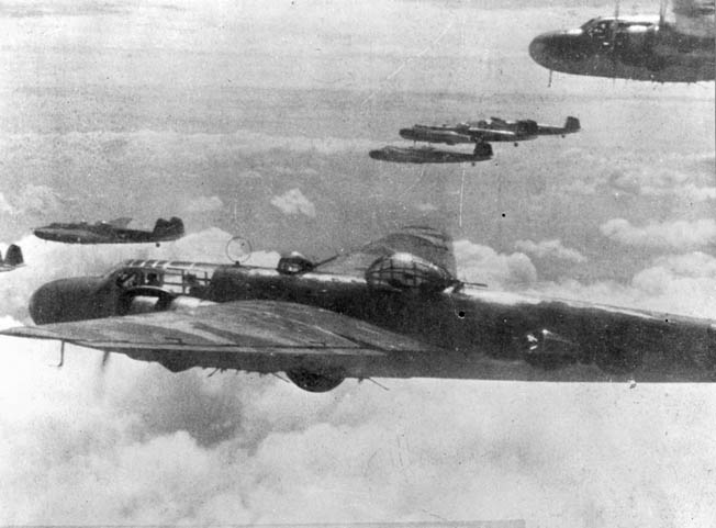 A flight of Japanese Navy Mitsubishi G3M Nell bombers wings its way toward a distant target. These bombers were heavily engaged during the attack on Darwin harbor on February 19, 1942.