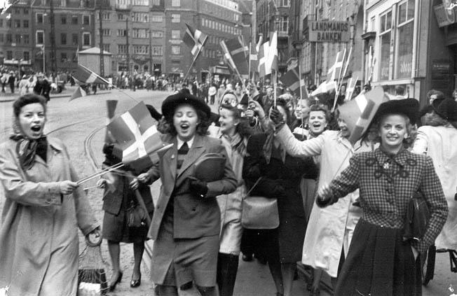 Copenhagen women joyously celebrate the liberation of Denmark, May 5, 1945. Nazi Germany surrendered three days later.
