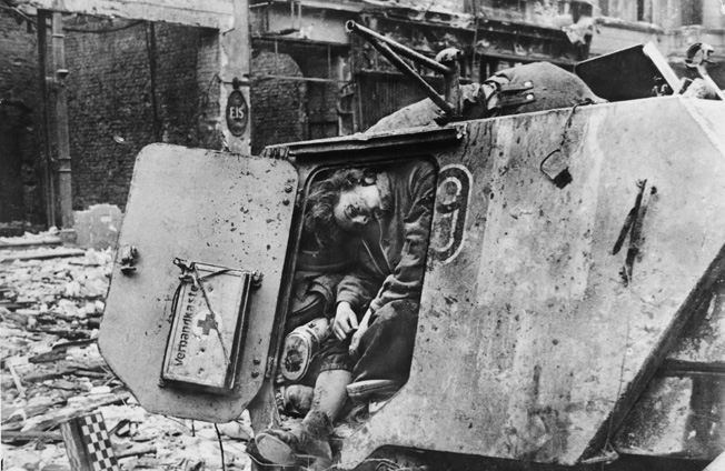 End of the line: After escaping from Russia, Scandinavian SS volunteers took part in the defense of Berlin. Here a dead soldier from SS Division Nordland met his end in an armored vehicle while a comrade lies dead above him, April 1945.