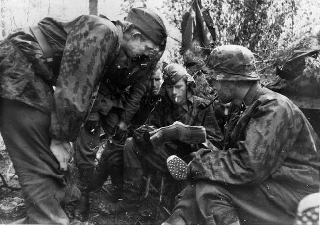 Men of Frikorps Danmark study a map, May-June 1942—about the time they lost two commanders.