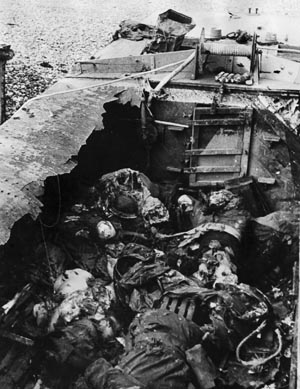 Many of the troops were killed before they made it to the beach, including these Canadians photographed in their burned-out landing craft. opposite: Wounded Canadians are carried off a Polish destroyer after returning from Dieppe.