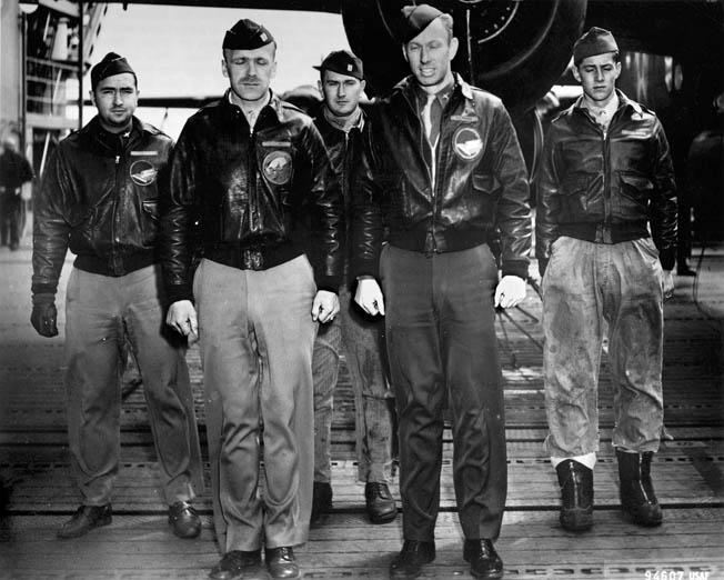 Crew of Plane 8, interned in Russia (left to right): Lieutenant Nolan A. Herndon, bombardier/navigator; Captain Edward J. York, pilot; Sergeant Theodore H. Laban, flight engineer/gunner; Lieutenant Robert Emmens, co-pilot; Sergeant David W. Pohl, gunner, not shown.