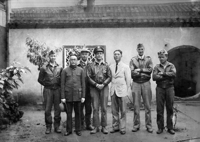The crew of Lieutenant Travis Hoover's Plane 2 pose with Tung-Sheng Liu, in white jacket, who helped the crew escape capture. Liu later immigrated to the United States and was named an honorary member of Doolittle's Raiders.
