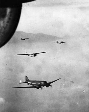 Waco CG-4A gliders carrying members of the 550th Glider Infantry Regiment are towed across the Mediterranean to landing zones in southern France.