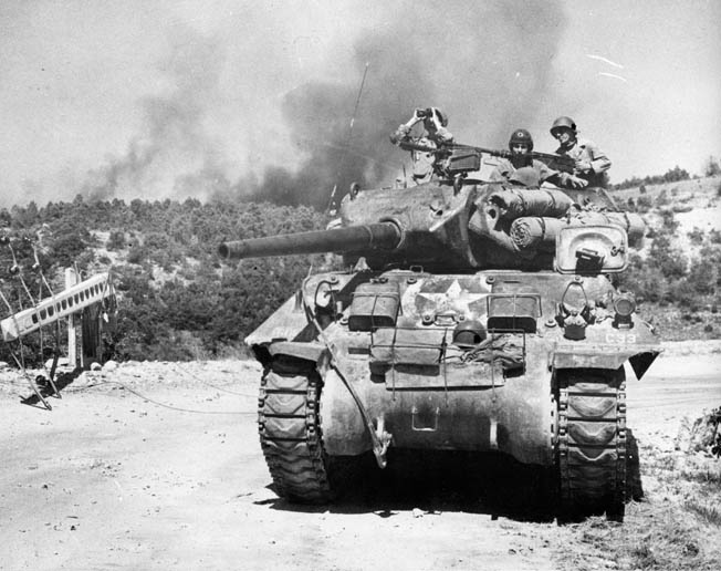 An American Sherman tank crew scans for Germans retreating up the Rhône Valley in southern France.
