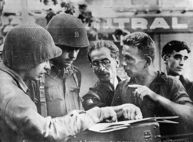 The Free French underground played important roles during the invasion. Here, a couple of FFI fighters give GIs information on German locations.