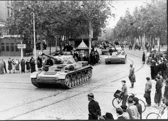 German armor rolls through Toulouse. After the Allies invaded southern France, the Germans retreated northward to try and make a stand in the Rhône Valley.