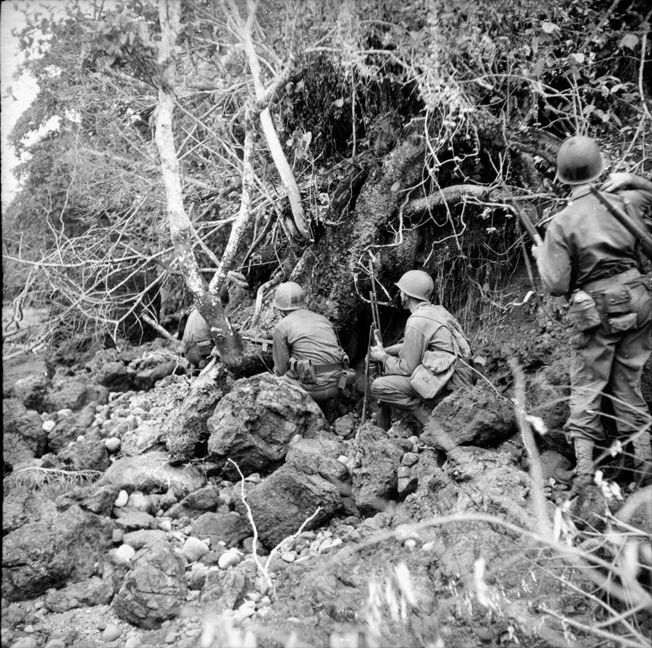 American soldiers crouch temporarily while on patrol through the jungles of New Guinea north of Aitape. Landings at Aitape and Hollandia gave General Douglas MacArthur confi- dence that his enemy was fixed, particularly due to decoded radio intercepts.