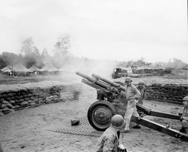 American artillerymen of the 152nd Field Artillery Battalion fire a 105mm howitzer at Japanese positions near Aitape. The prolonged days of fighting at the Driniumor River took their toll on both sides, but in the end the Japanese were decimated.