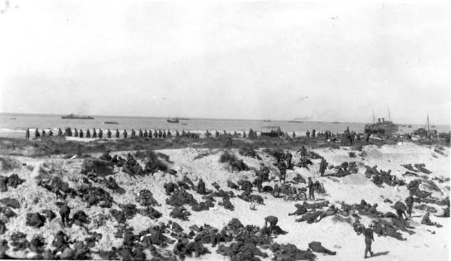 The beach at Dunkirk is packed with troops awaiting evacuation. As the threat of capture increased, the British altered their evacuation tactics.