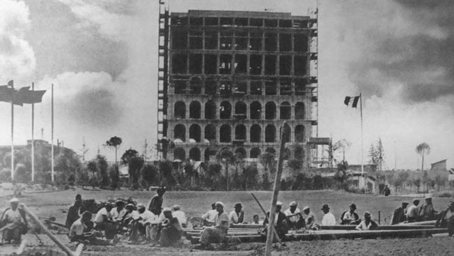Workers take a break while constructing the Palazzo della Cività Italiana, 1939. Adolf Hitler, who fancied himself an artist and architect, was greatly influenced by fascist Italy's designs and wanted something even more impressive for Germany.