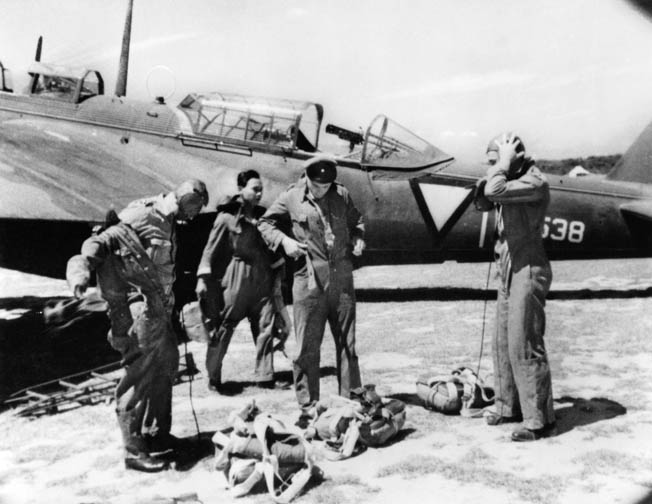 Dutch pilots on Sumatra prepare for flight operations against the Japanese in early 1942. Most aerial opposition was eliminated early in their campaign to capture the island.
