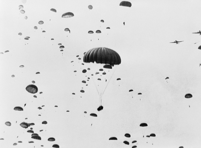 Unlike the night drops during the Normandy invasion, the paratroopers jumped into Holland during daylight. Here men and supplies parachute into Nijmegen.